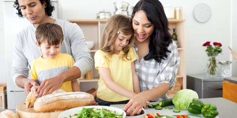Happy family preparing healthy food